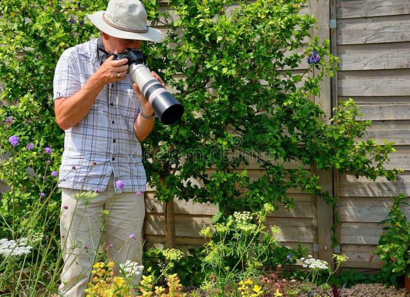 Fotografo senior fotografie stock