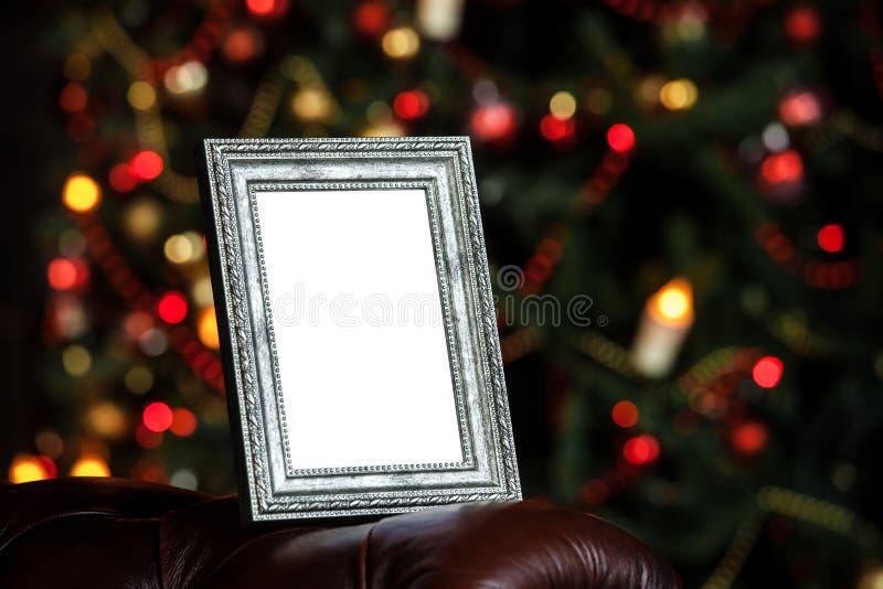 Fotokader op Kerstmis verfraaide achtergrond royalty-vrije stock afbeelding