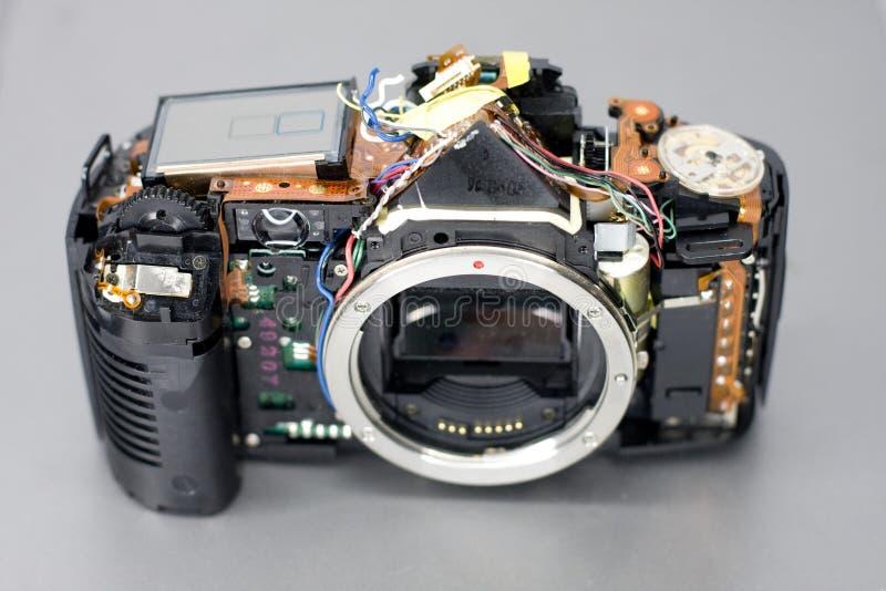 Fotokamera Beging repariert lizenzfreie stockbilder