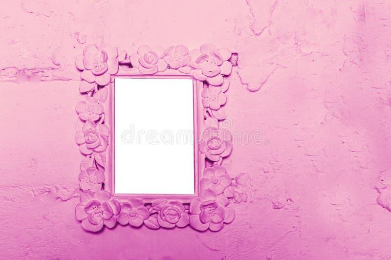 Fotorahmen auf der rosa Wand mit Raum für Text stockfotografie