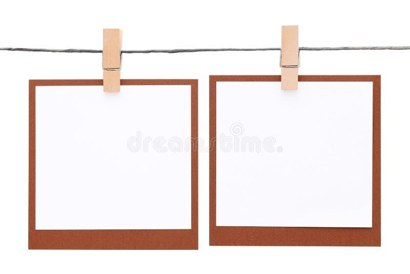 Fotoram som hängs på rep med klädnypan royaltyfri foto