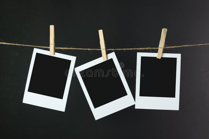 Fotos, die am Seil hängen stockfotos