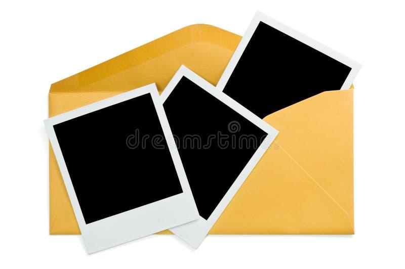 Fotos do instante do envelope e do espaço em branco fotografia de stock