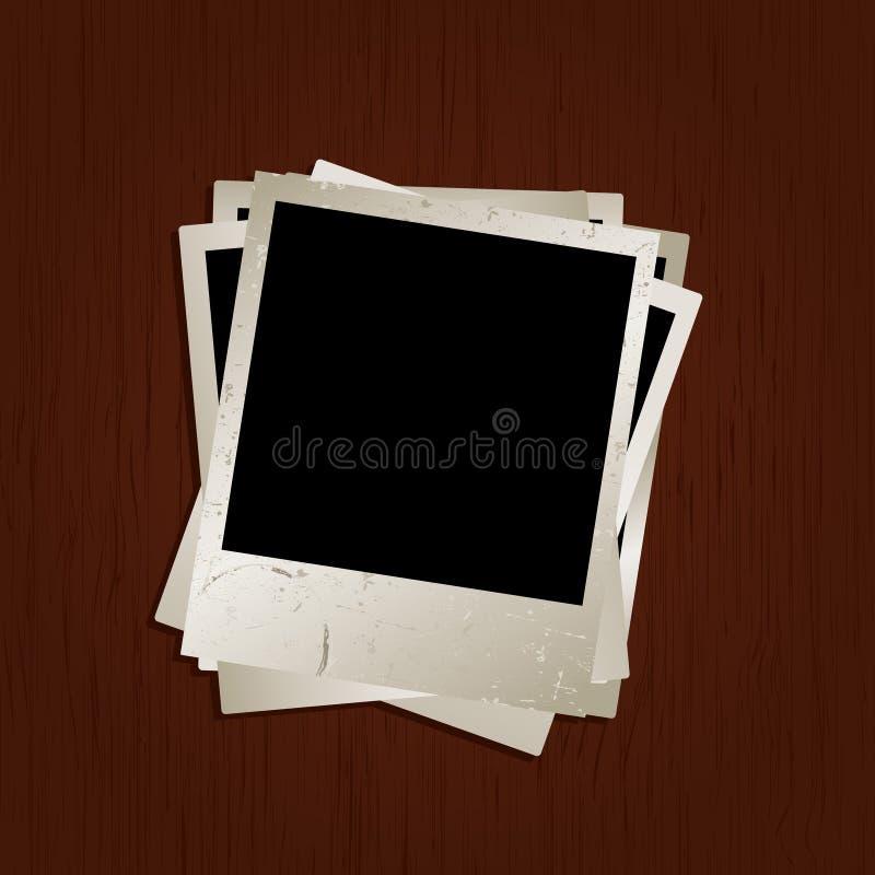 Fotos em branco no fundo de madeira ilustração royalty free