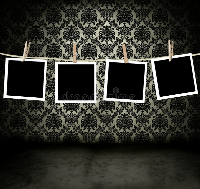 Fotos que cuelgan en un cuarto oscuro stock de ilustración