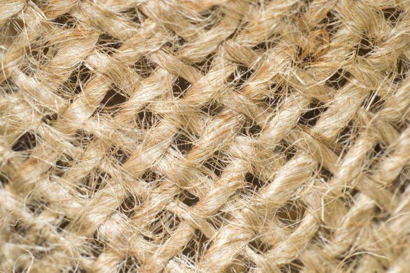 Fototextur av ljus färg för säckväv som göras från naturligt linnematerial royaltyfri bild