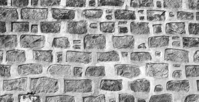 Fototextur, forntida grå stenvägg arkivfoton