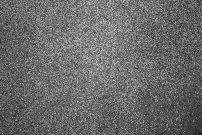 Fototextuur van de rijweg, de steen of het graniet, asfalt met grote deeltjes, grijze weg stock fotografie
