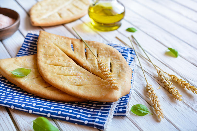 Fougasse - traditional French flat bread. Sprinkled with salt royalty free stock photo