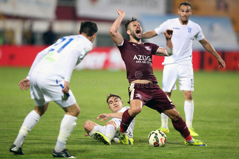 Foul during soccer or football match. Rapids Tomas Josl fouled by the defender of CSU Craiova, Bogdan Vatajelu during the match between Rapid Bucaherst and CSU royalty free stock photography