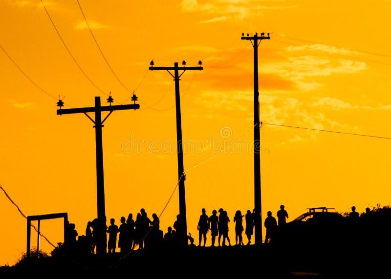 Coucher du soleil de attente de personnes images libres de droits