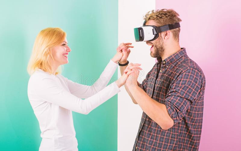 Found out how to teach him dance. Virtual reality dance school. Man vr glasses dancing with happy smiling girl. Learn. Movement from cyber teacher in virtual royalty free stock photo