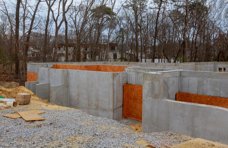 Foundation of concrete construction works in new homes. Unfinished construction house building activity housing underground wall development site preparation stock photography