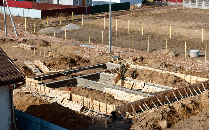 The Foundation of the house under construction, fresh concrete Foundation, cement-filled Foundation of a private house stock photography