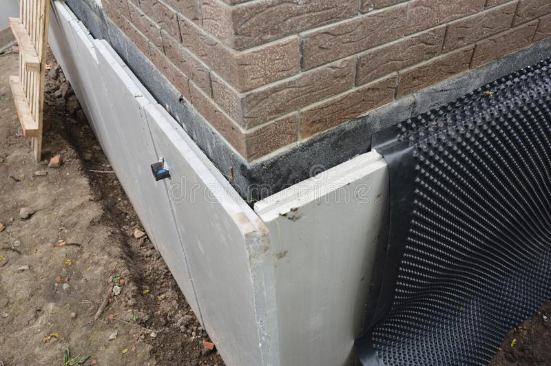 Foundation insulation and Damp proofing in problem corner area. House basement,foundation insulation details with waterproofing. And Damp Proof membranes photo royalty free stock images
