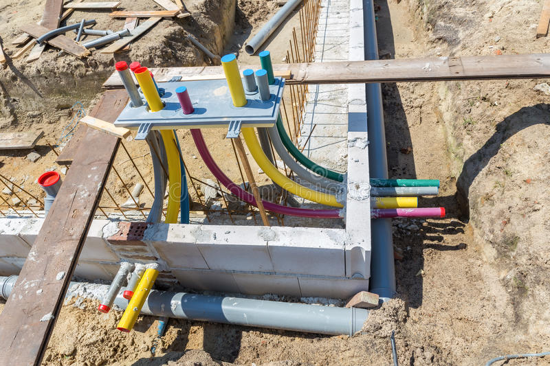 Foundation with pipes on building site stock photo
