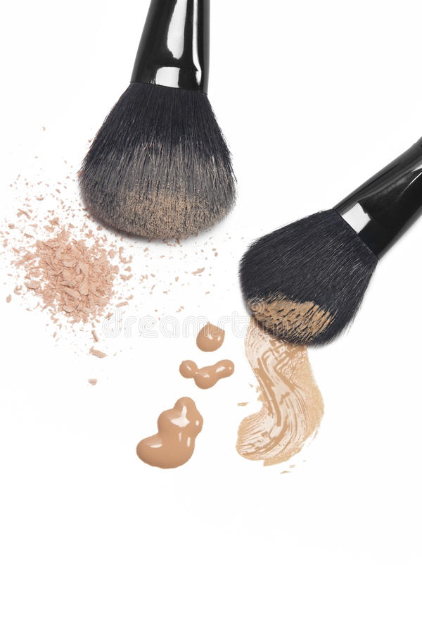 Foundation and powder with brushes stock photo