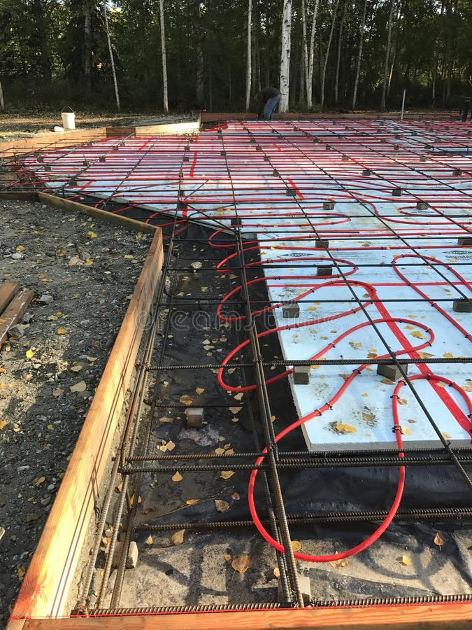 Foundation with radiant heat ready for concrete. Radiant heat monolithic slab ready for concrete royalty free stock photos