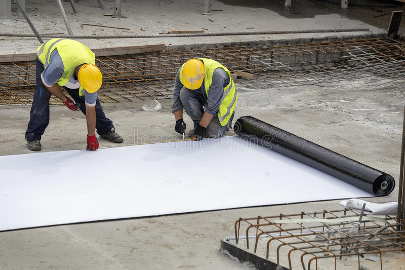Foundation waterproofing installation. Preparing for foundation waterproofing installation at construction site stock image