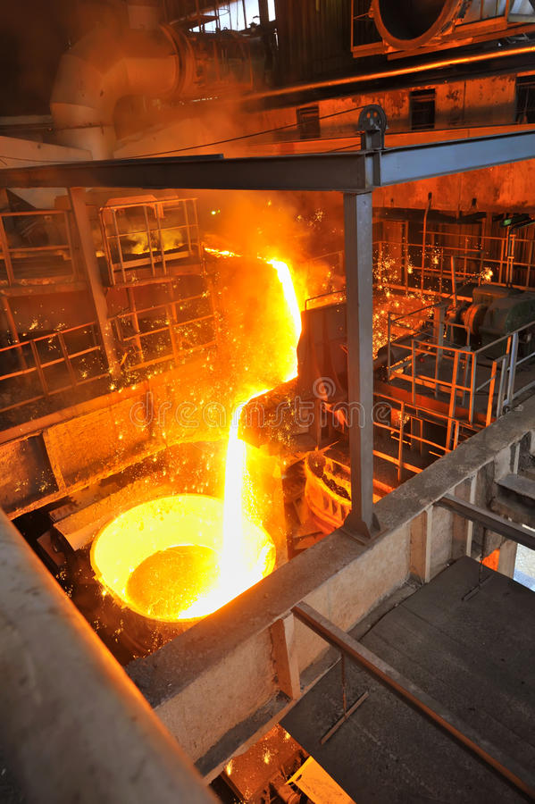 Foundry - molten metal poured. Shoot inside of plant royalty free stock photos