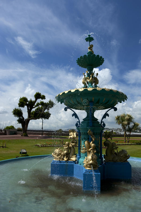 Fountain. Ornate cast iron fountain with Nymphs in a seafront park Torquay stock photos