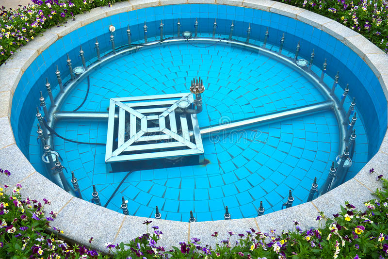 Fountain. Circular fountains, filled with water royalty free stock photos