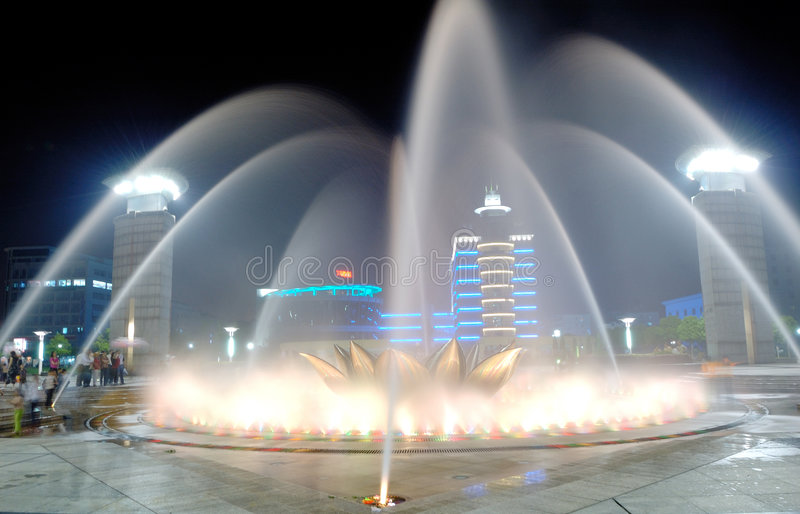 Fountain 2. Varicoloured fountain on the square at night stock photography
