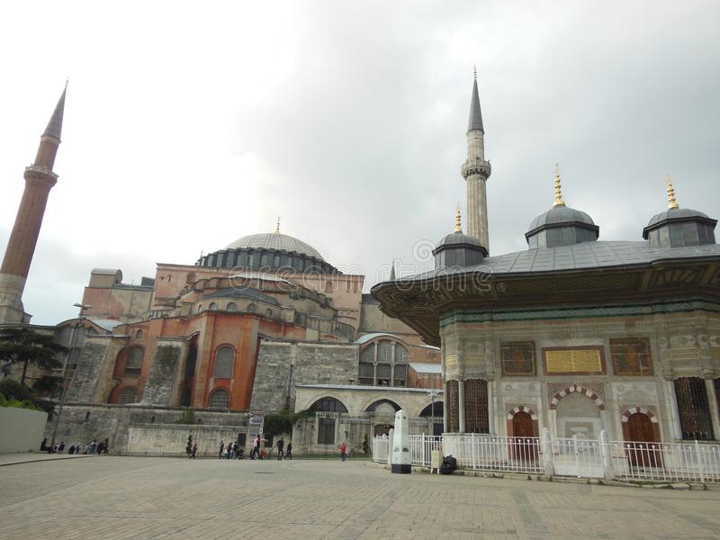 The Fountain of Ahmed III and Hagia Sophia museum in background, Istanbul. Turkey stock photo