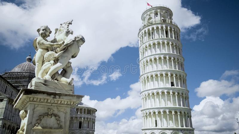 Fountain with Angels and Leaning Tower of Pisa in Italy architecture sightseeing stock images