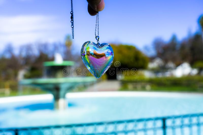 Fountain backgroundheart crystal glass refract sunlight - fountain background. AT 1/4/2019 in Rose garden royalty free stock photography