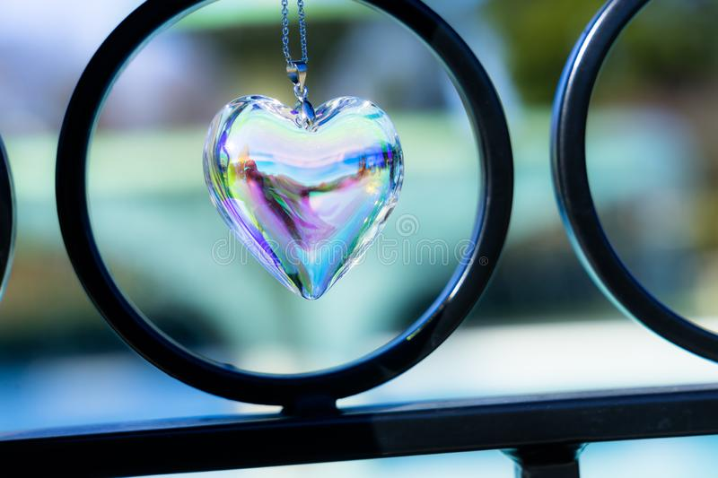 Fountain backgroundheart crystal glass refract sunlight - fountain background. AT 1/4/2019 in Rose garden stock photography