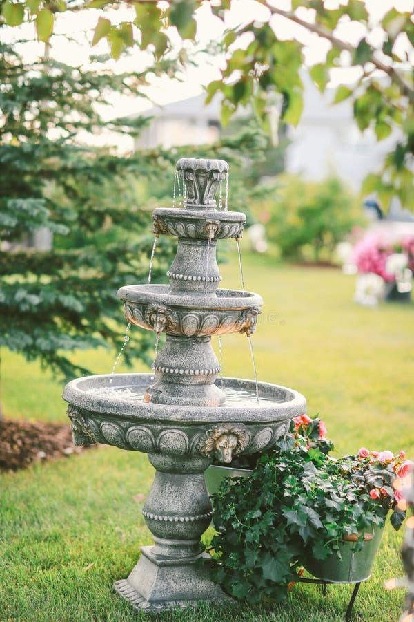 Fountain in backyard stock image
