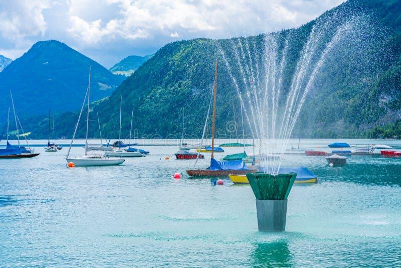 Fountain and boats on Wolfgangsee lake. In St. Gilgen, Salzkammergut region, Austria stock photo