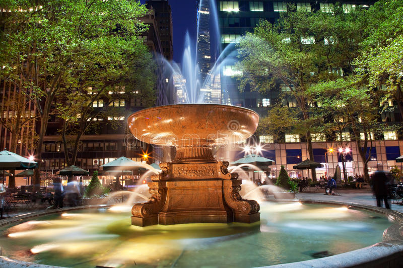 Fountain Bryant Park New York City Night. Fountain Bryant Park New York City Apartment Buildings Night Faces blurred trademarks removed royalty free stock photos