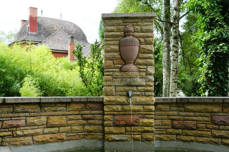 Fountain at cemetery by crematorium in tuttlingen. At danube in south germany stock photos