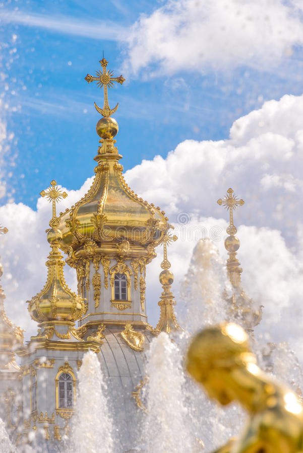 Fountain and church of the palace of Peterhof. St Petersburg, Russia. Fountain and church of the palace of Peterhof in St Petersburg, Russia royalty free stock photos