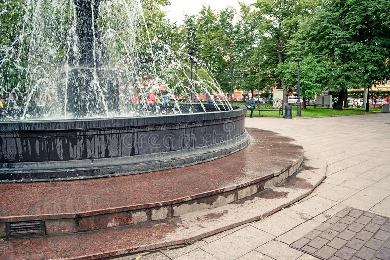 Fountain in city park on summer day. stream of water, drops and bright splashes of water in beautiful city fountain royalty free stock photos
