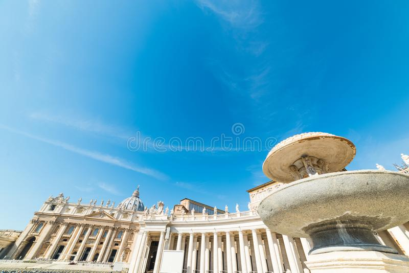 Fountain and colonnade in Saint Peter`s square royalty free stock image