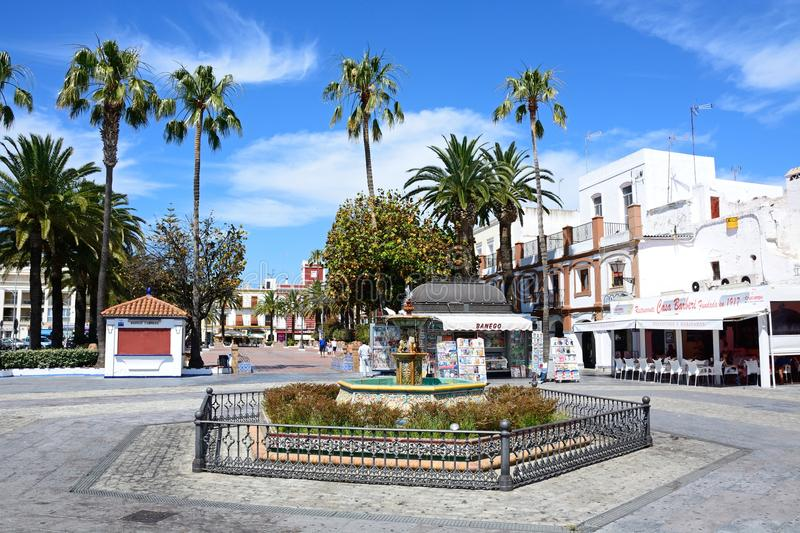 Fountain in Coronation Square, Ayamonte. Pretty ceramic fountain in Coronation Square Plaza de la Coronacion with a newsagent kiosk to the rear, Ayamonte royalty free stock photo