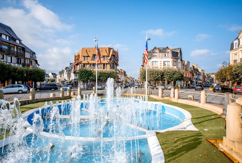 Fountain in Deauville, France. DEAUVILLE, FRANCE - September 06, 2017: Central fountain on the road crossings in Deauville, famous french town in Normandy stock image