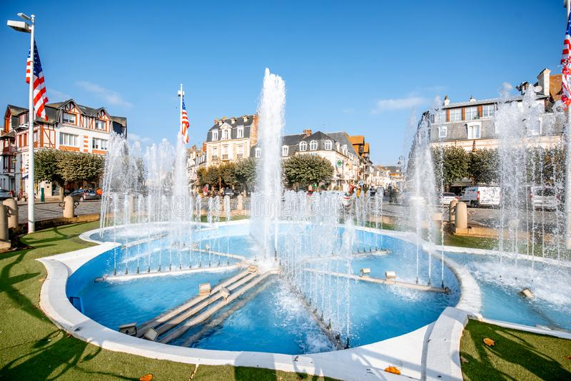 Fountain in Deauville, France. DEAUVILLE, FRANCE - September 06, 2017: Central fountain on the road crossings in Deauville, famous french town in Normandy royalty free stock images