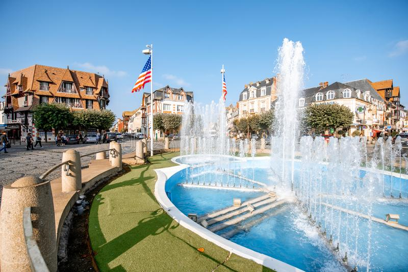 Fountain in Deauville, France. DEAUVILLE, FRANCE - September 06, 2017: Central fountain on the road crossings in Deauville, famous french town in Normandy royalty free stock photos