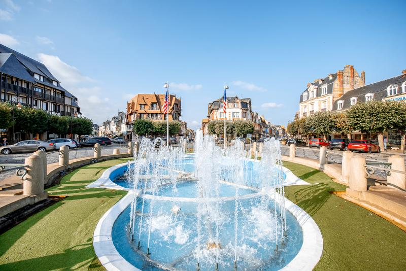 Fountain in Deauville, France. DEAUVILLE, FRANCE - September 06, 2017: Central fountain on the road crossings in Deauville, famous french town in Normandy royalty free stock image