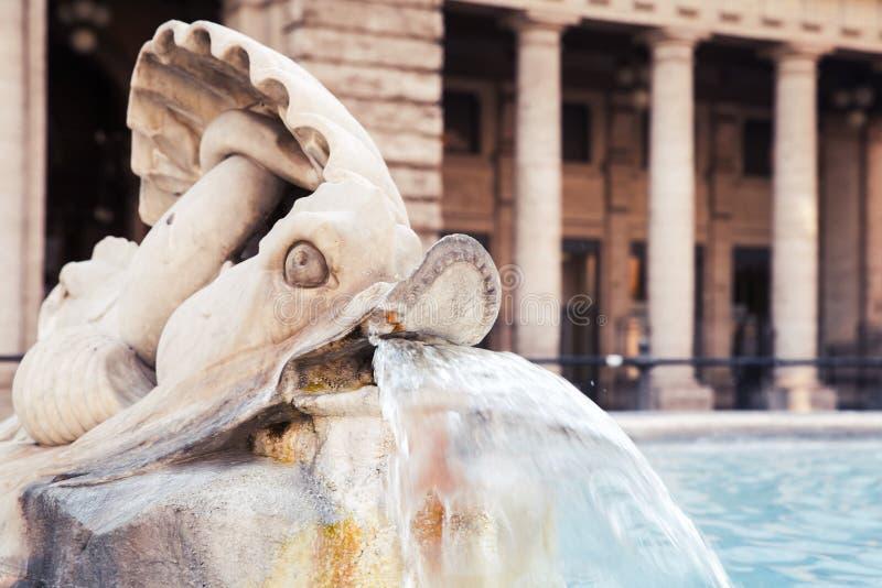 Fountain with dolphin sculpture. Italy, Rome. Fragment of fountain with dolphin sculpture. Italy, Rome, Piazza Colonna, Via Del Corso stock image