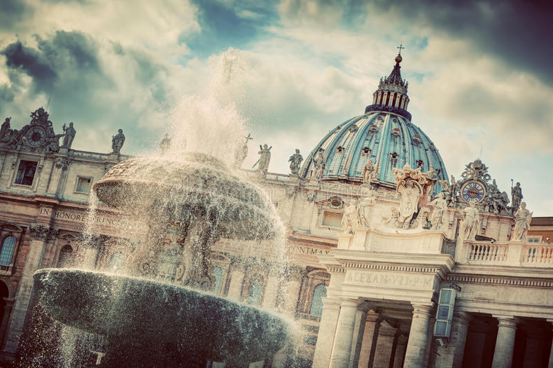 The fountain and the dome of St. Peter's Basilica in Vatican City. royalty free stock photos