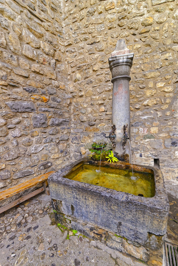 Fountain with drinking water in Courtyard of Chillon Castle stock images