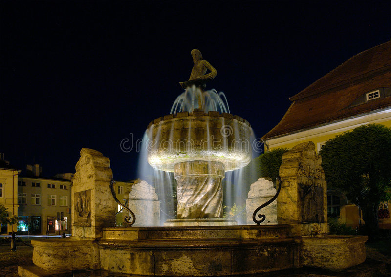 Fountain, fisherman statue. stock photography