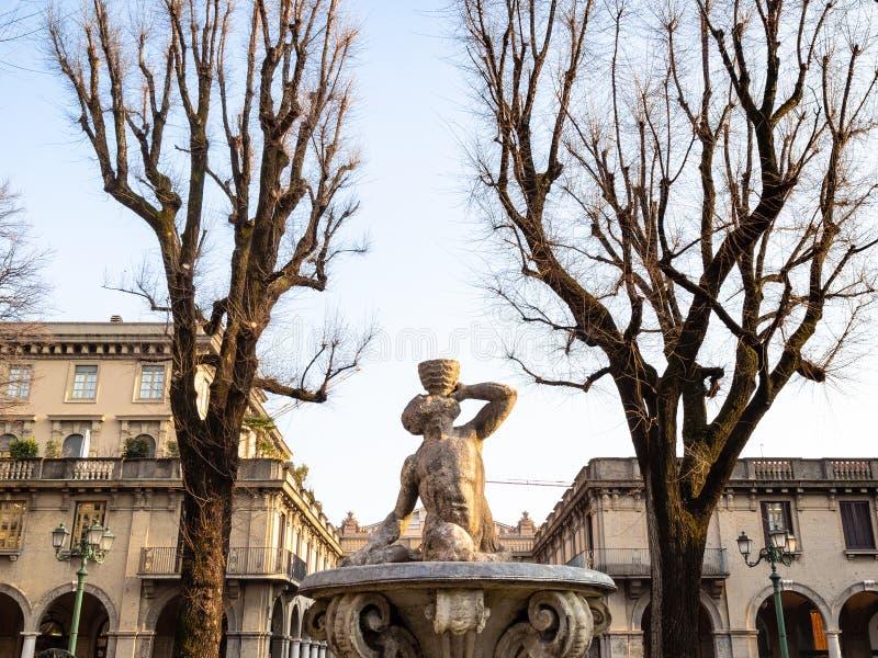 Fountain Fontana della Fiera in Bergamo city. Travel to Italy - medieval fountain Fontana della Fiera o del Tritone (Fontana di Piazza Dante) on square Piazza royalty free stock photography
