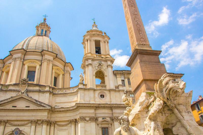 Fountain of the Four Rivers with an Egyptian obelisk and Sant Agnese Church on the famous Piazza Navona Square. Sunny summer day. Rome, Italy. Architecture and royalty free stock photography
