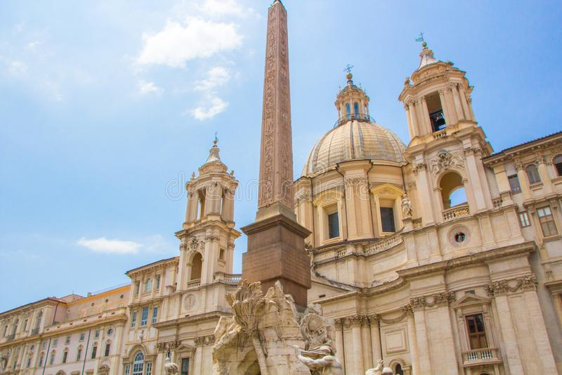 Fountain of the Four Rivers with an Egyptian obelisk and Sant Agnese Church on the famous Piazza Navona Square. Sunny summer day. Rome, Italy. Architecture and royalty free stock images